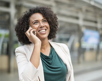 Happy woman on phone outside